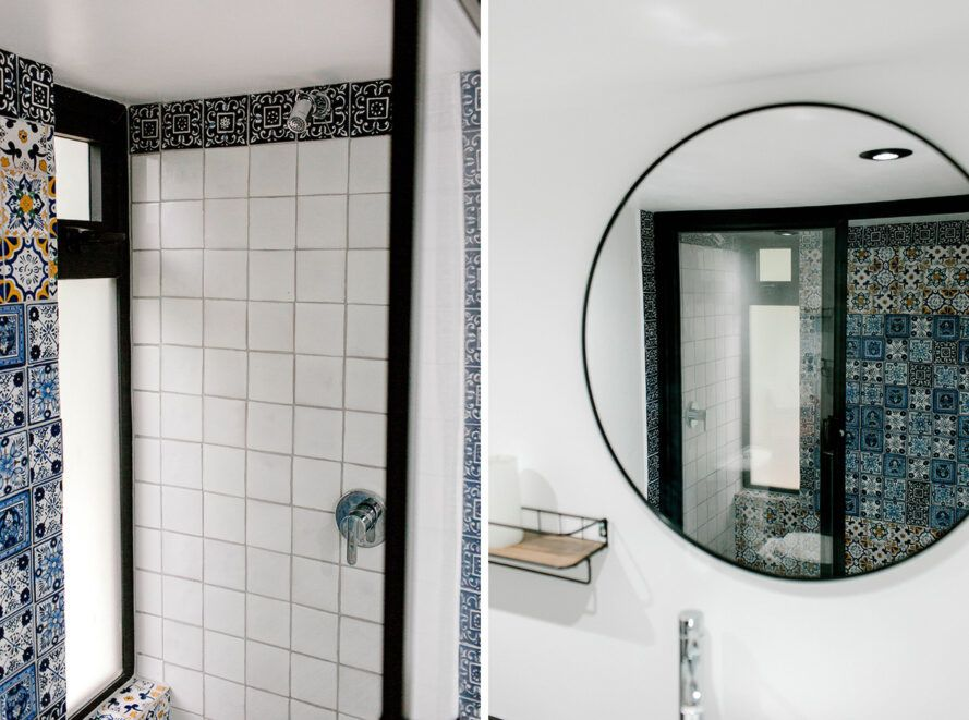 bathroom with hand-painted shower tiles