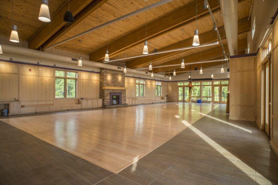 large wood room with brick fireplace