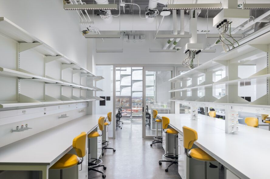 Laboratory with white tables and orange chairs