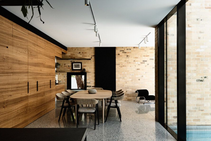 The dining room with dining table and chairs uses wood and black color schemes.