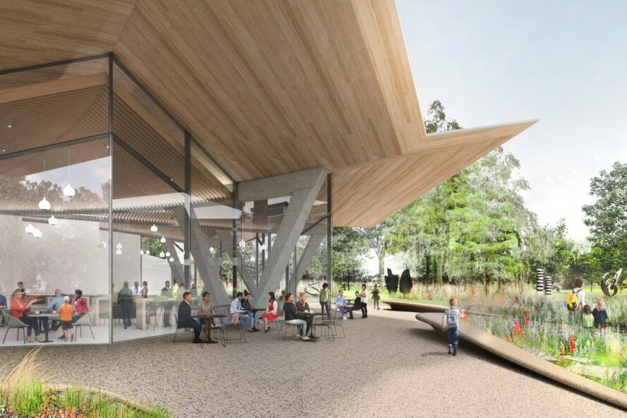 rendering of patio space and gardens next to glass building