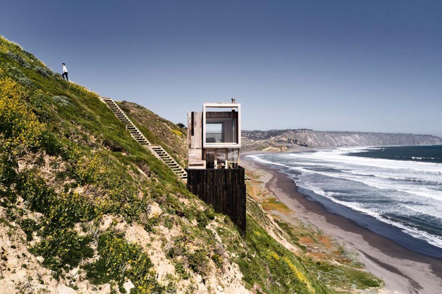 Black and white wooden house by the sea