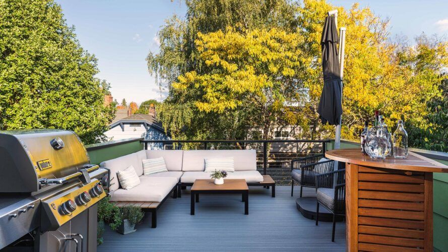white sectional sofa on rooftop deck