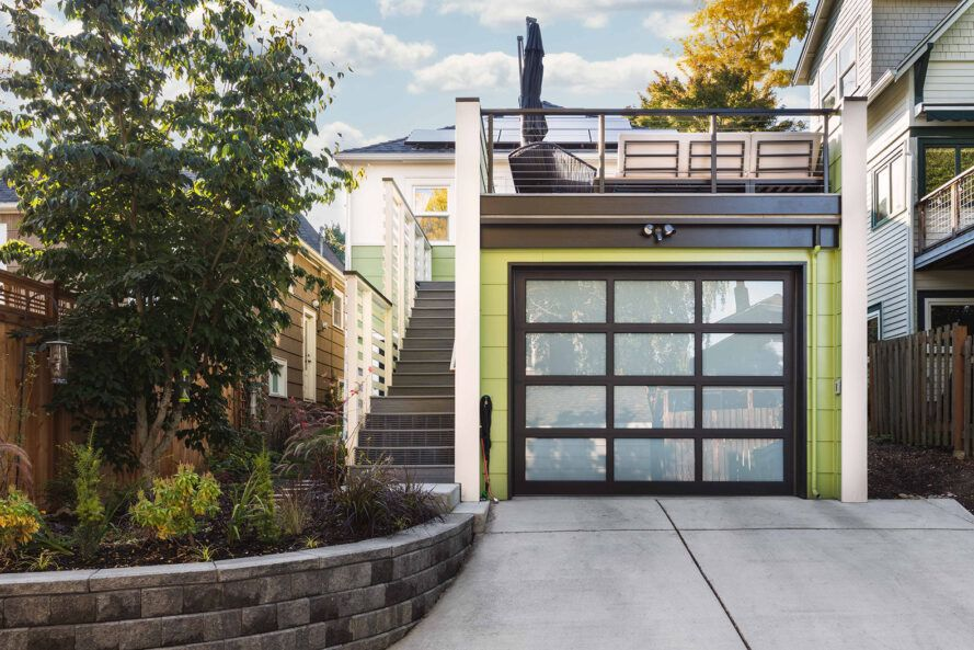 green garage with rooftop deck