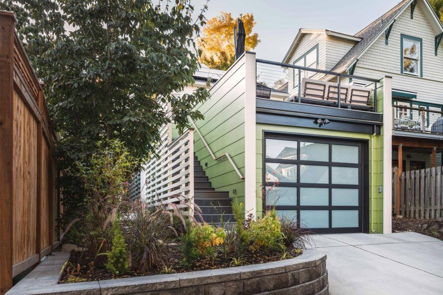 green and white garage with roof deck