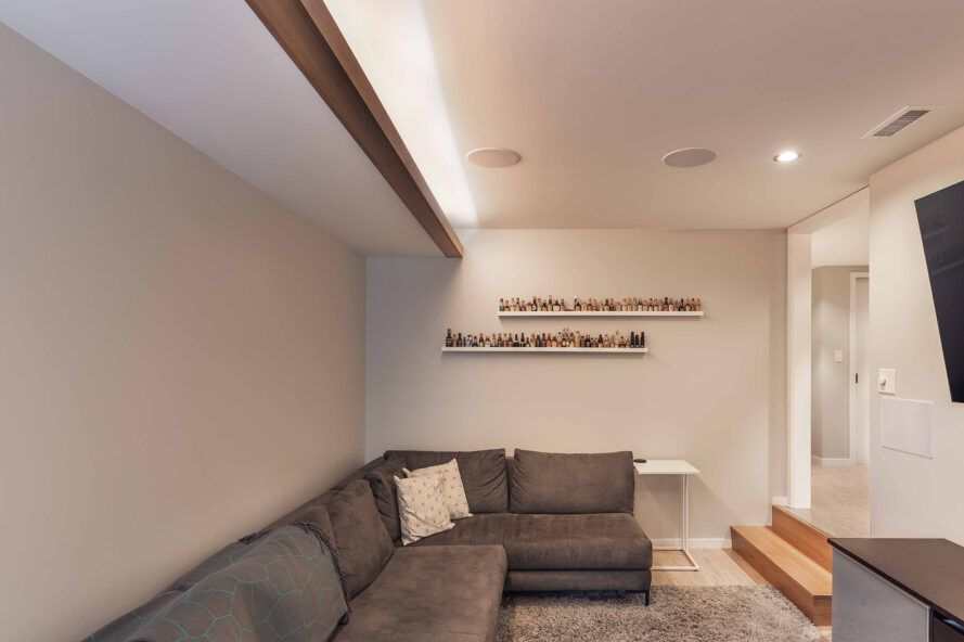 gray sectional sofa in finished basement