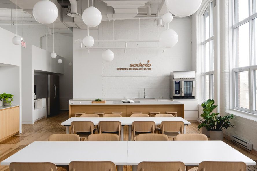 white dining tables with wood chairs in office kitchen