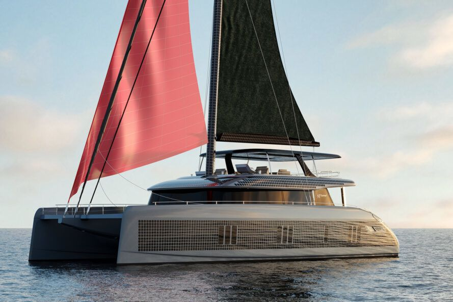 Rendering of a gray yacht with solar panels on the side and red sails sailing on the ocean
