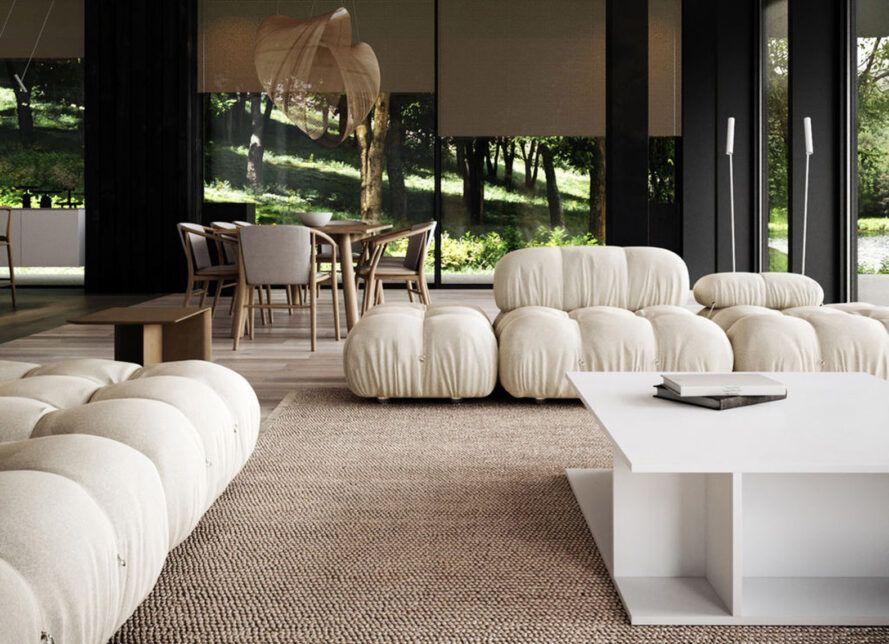 A neutral-toned living room with white sofas.