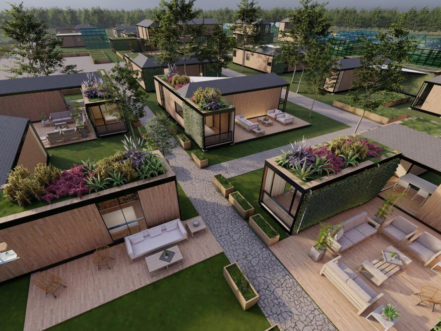 aerial view of wood and black tiny homes with green roofs and outdoor patios