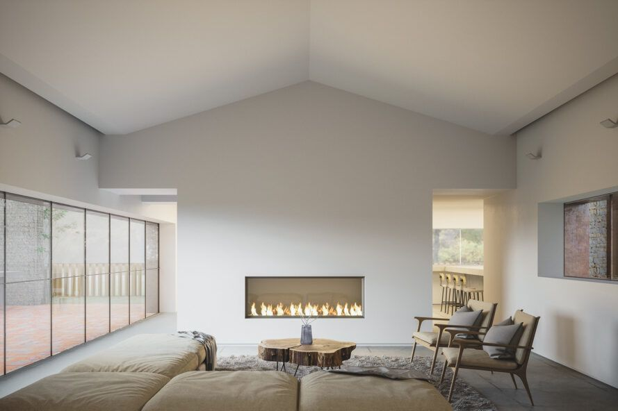 A living room with minimalist design, white walls, a fireplace and a beige sofa and chair.