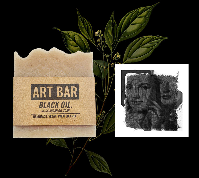 beige bar of soap next to art print with two faces