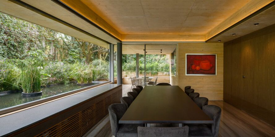 Long table in a room with glass walls