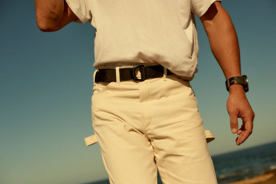 People wearing white clothes and black recycled plastic utility belts