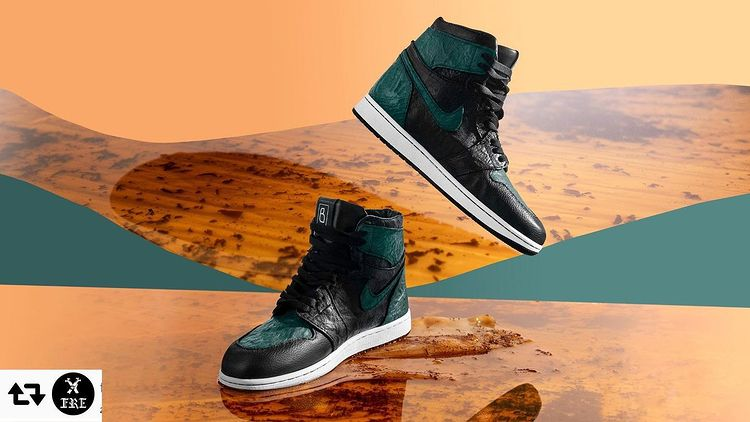 A pair of dark blue-green sneakers on an abstract wooden background.