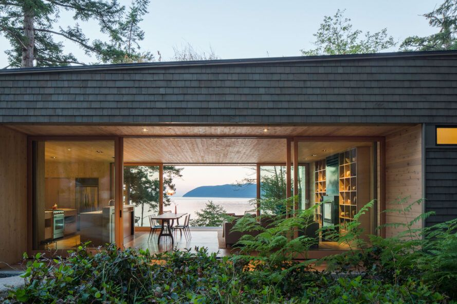 Wooden house with glass walls and views of the Pacific Ocean