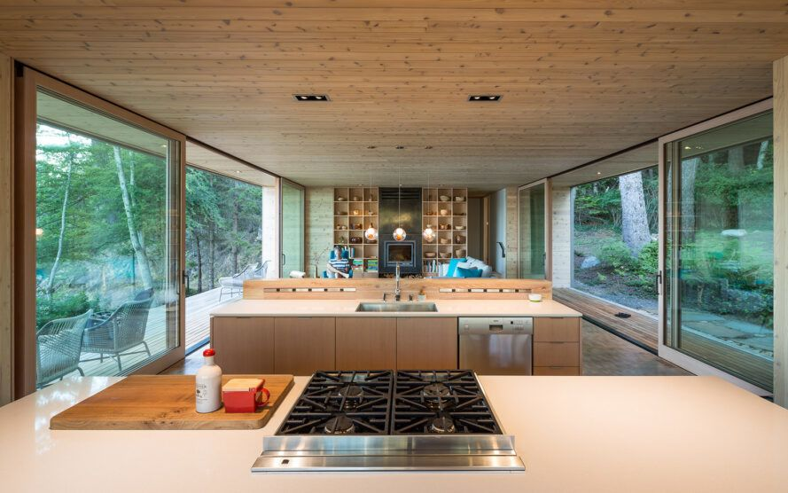 Home light wood kitchen with glass walls