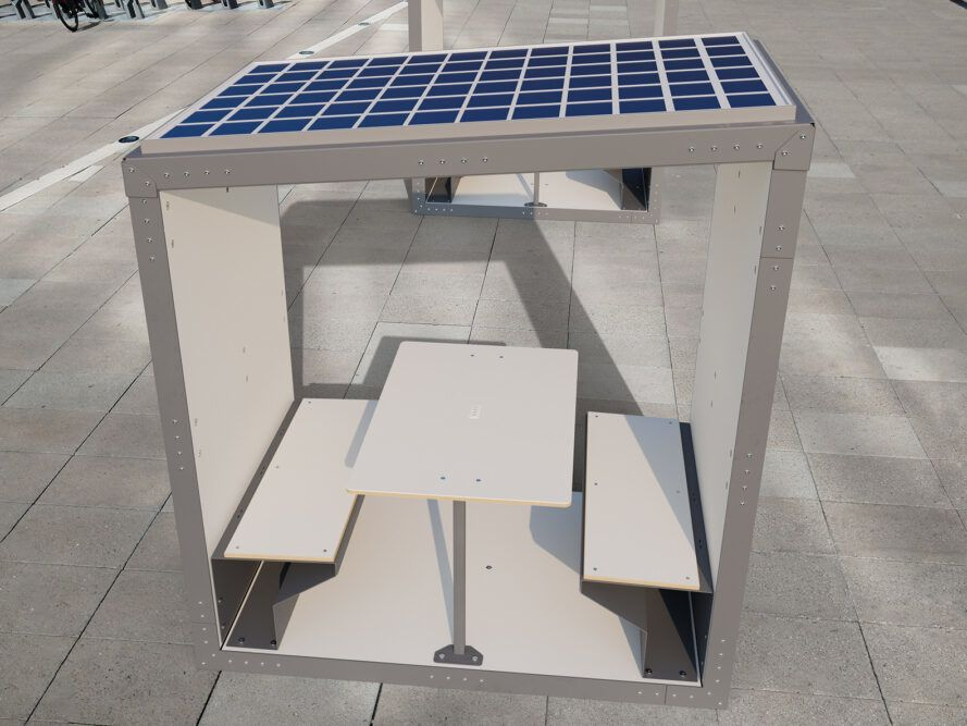 office pod with table and benches plus solar panels on roof