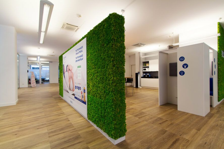 office with central wall covered in moss