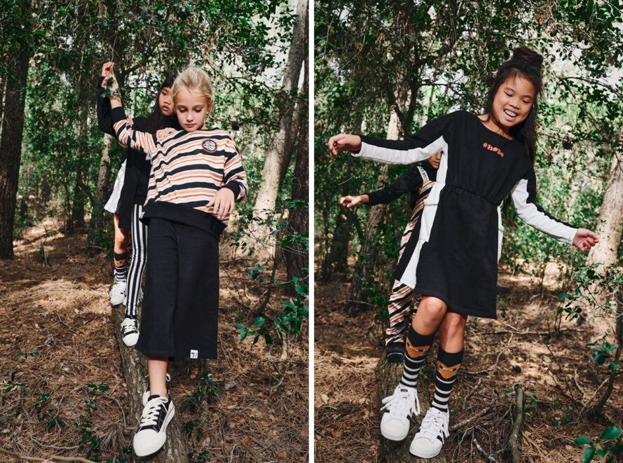 Children in striped shirts and dresses