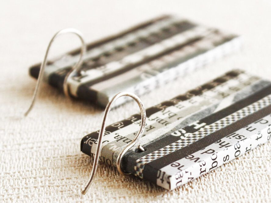 Black and white rectangular earrings made from recycled newspaper