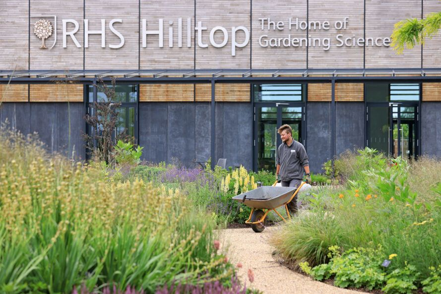 Aiden Couzens, horticulturalist, making final preparations to the Wellbeing Garden at RHS Hilltop.