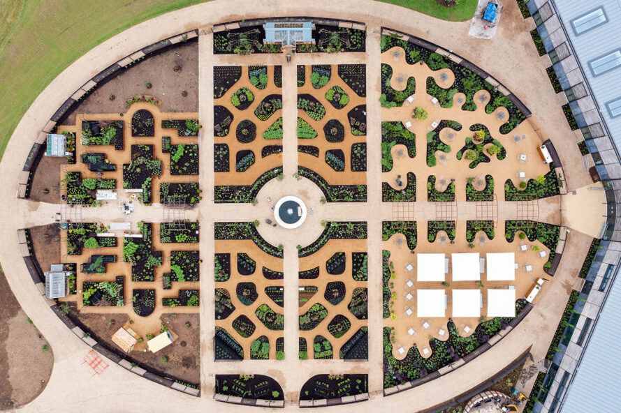 An aerial view of the World Food Garden, showing a complex design with a roundabout in the middle, branching from four directions to different parts of the garden.