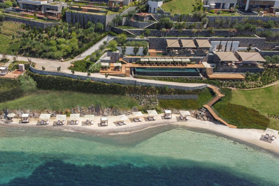 aerial view of hotel made up of various villas near beach