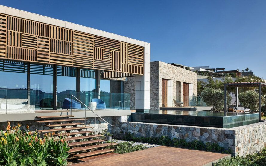 white villa with wood patterned screen over windows