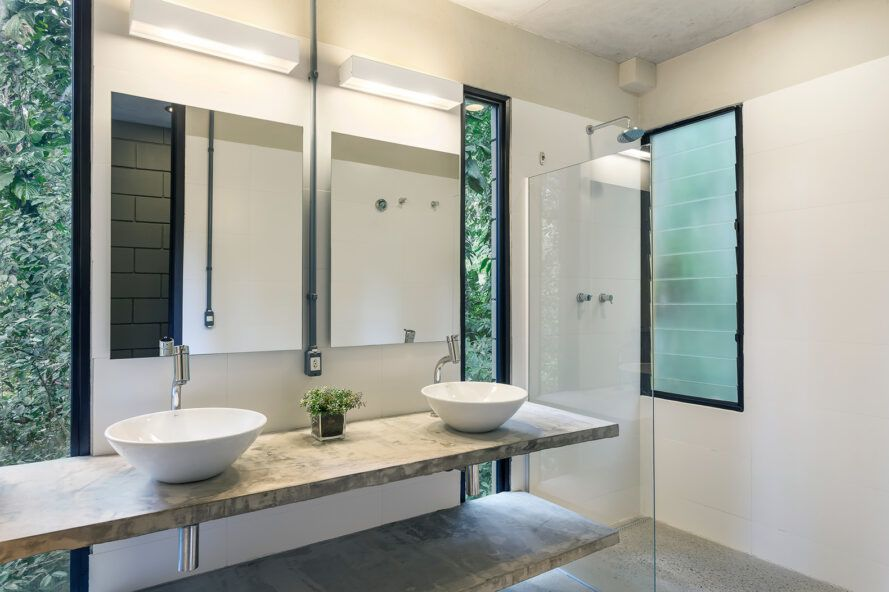 White bathroom with light wood decoration