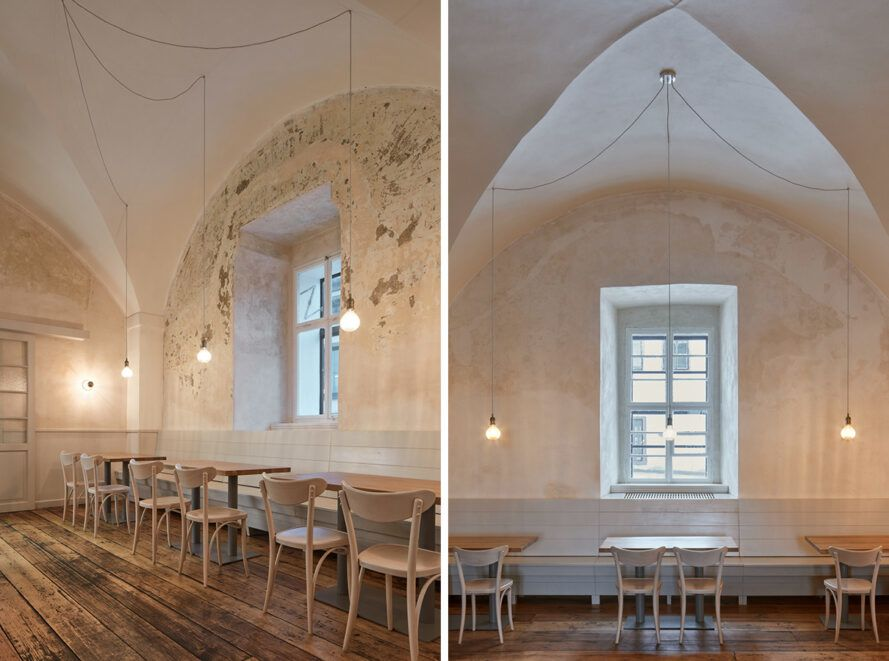 The dining room features wooden tables, old wooden floors and vaulted ceilings