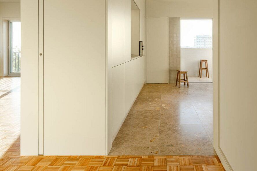 The left side of the corridor is the living room, and the right is the kitchen.
