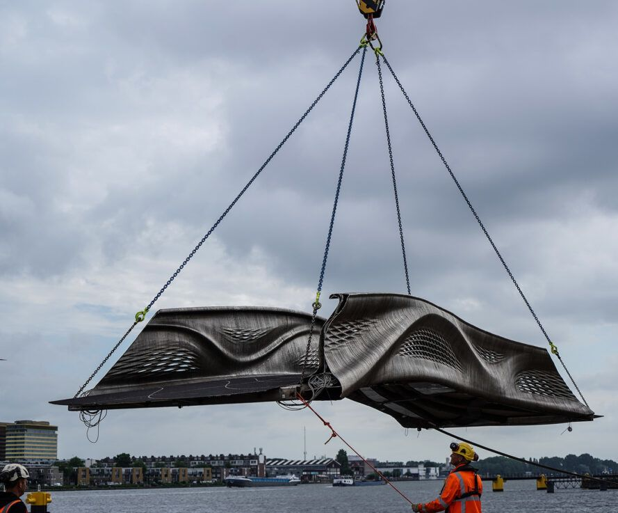 3D-printed bridge piece being airlifted into place