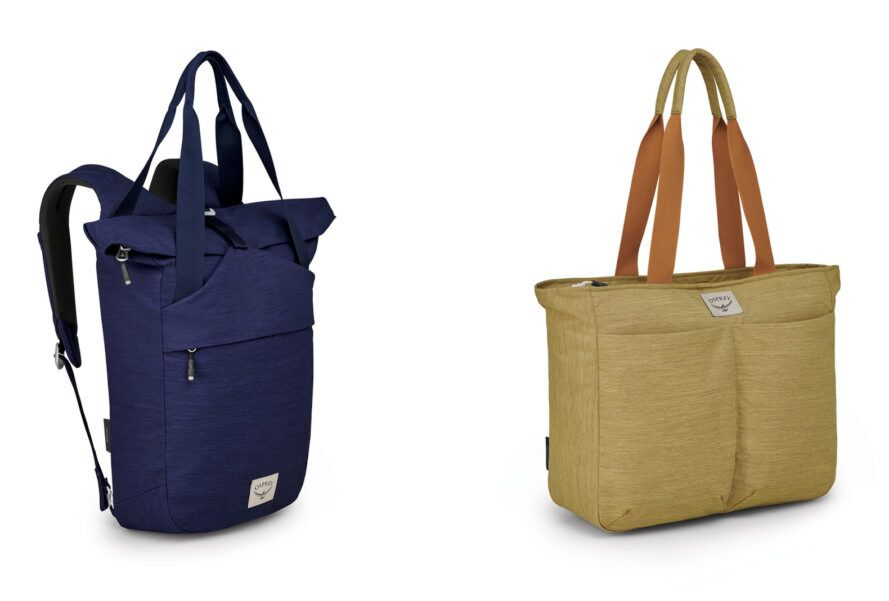 To the left, a blue backpack. To the right, a tan tote bag.