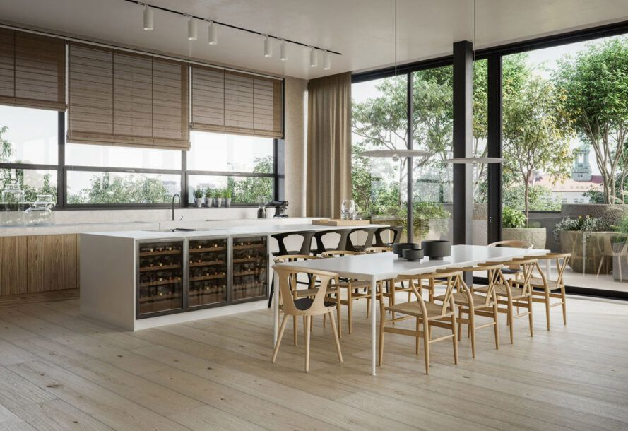 A kitchen with white counters, wood floors and a table with chairs.