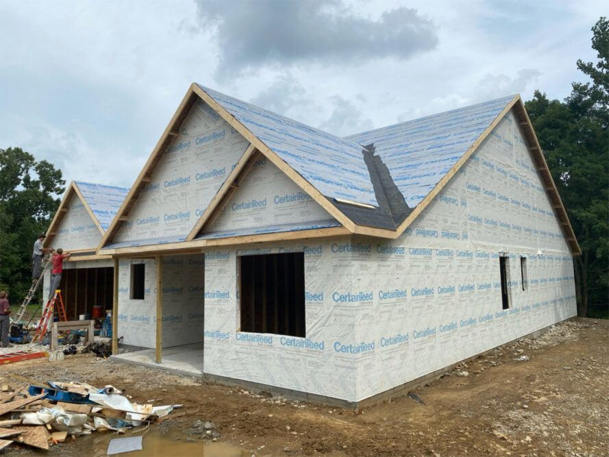 Front and side facades of house under construction