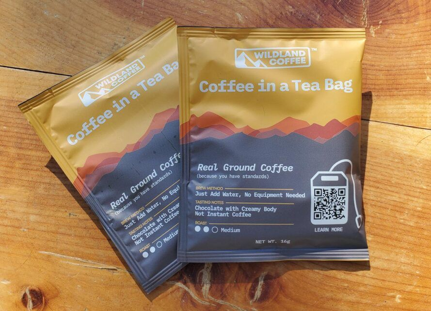 Two orange and gray packets of coffee.