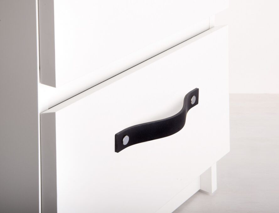 Black strap handle on a cabinet
