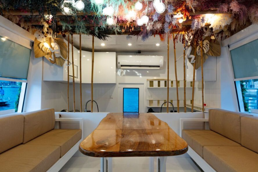 Fixed central table flanked by two seating benches resembling a ships interior