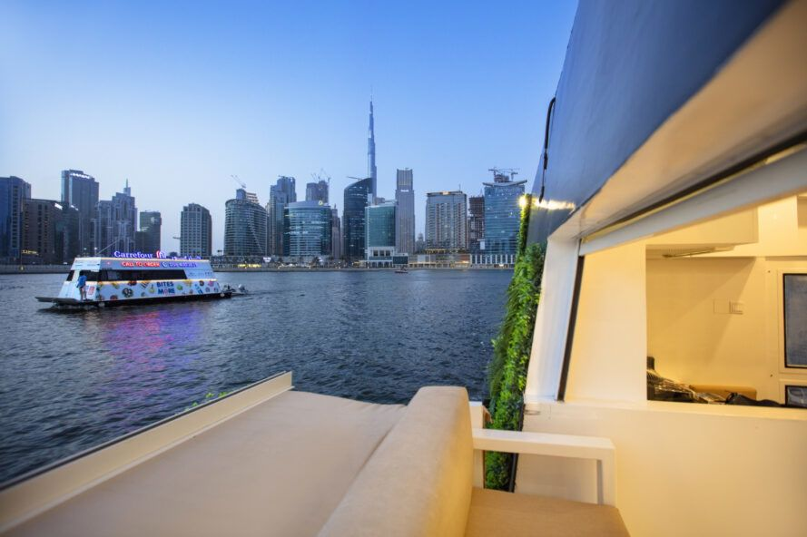 View toward the Dubai skyline in the evening from the edge of the pod