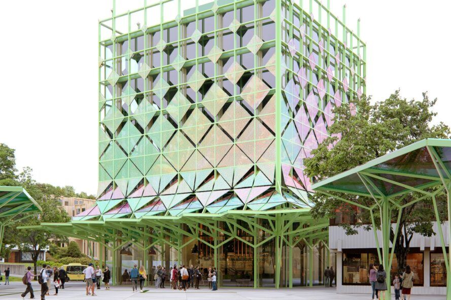 A colorful multi-level building with a light green frame.
