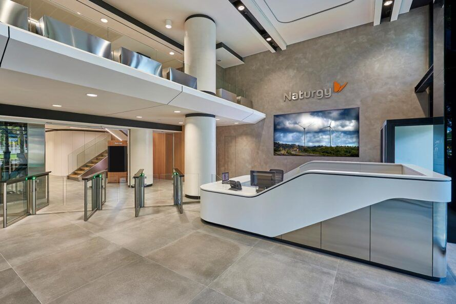 A neutral-toned lobby with a Z-shaped front desk.