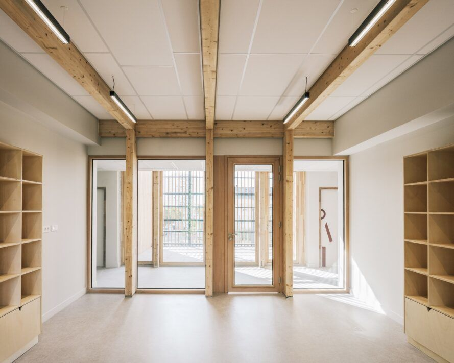 Open floor length windows of a classroom facing another room