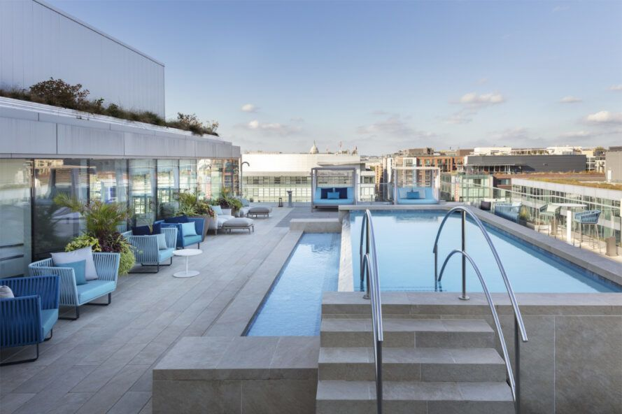 Outdoor lounge with pool overlooking the Washington D.C. cityscape.