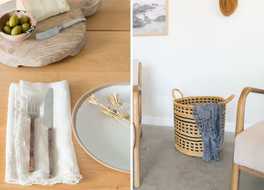 To the left, a table setting with utensils on a napkin next to a plate. To the right, a wicker-like basket with a blue blanket in it, next to a wood armchair.