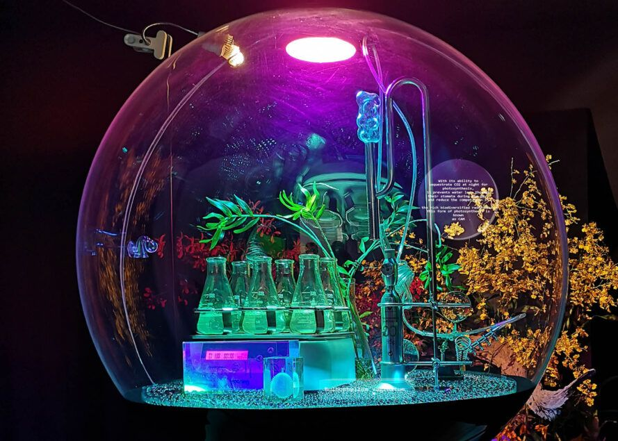 A transparent bubble with science beakers and equipment inside.