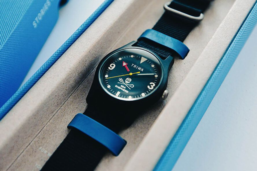 A black watch in a white and blue case.