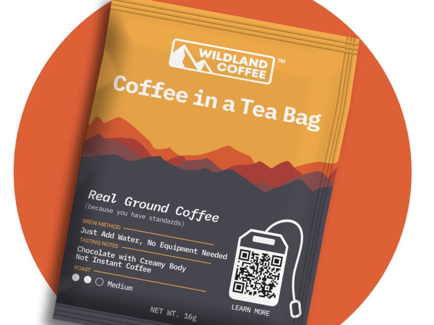 An orange and gray packet of coffee.