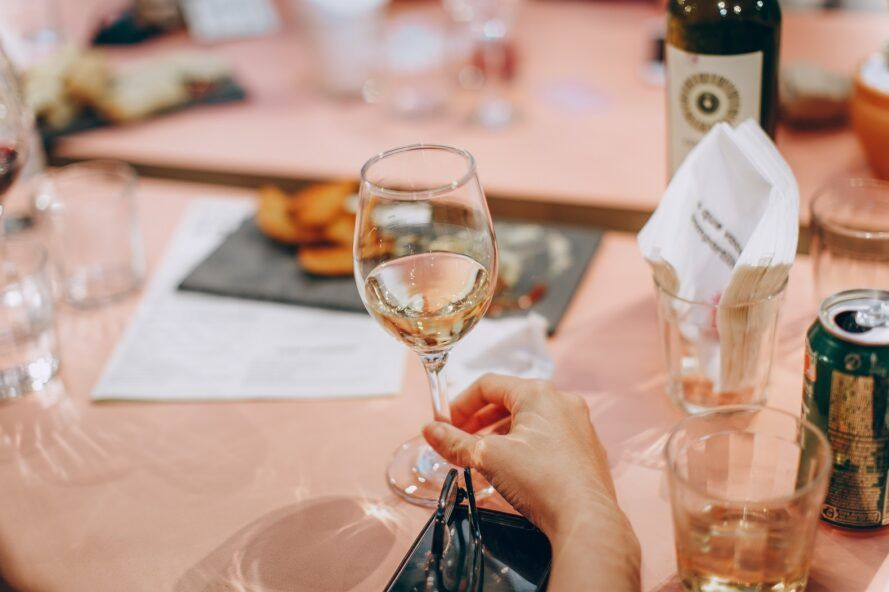 A hand holding a champagne glass