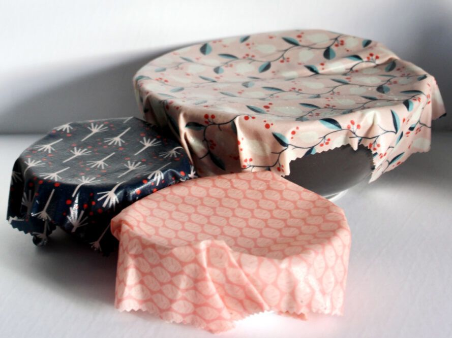 Three bowls of various sizes covered in patterned beeswax wraps